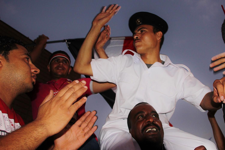 policeman celebreation demonstration egypt tahrir square