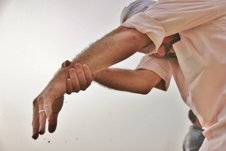 demonstrater injured hand cairo egypt