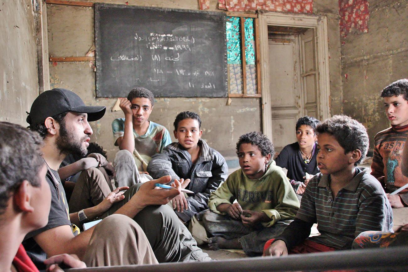 activist take care street boys explaining listening cairo egypt