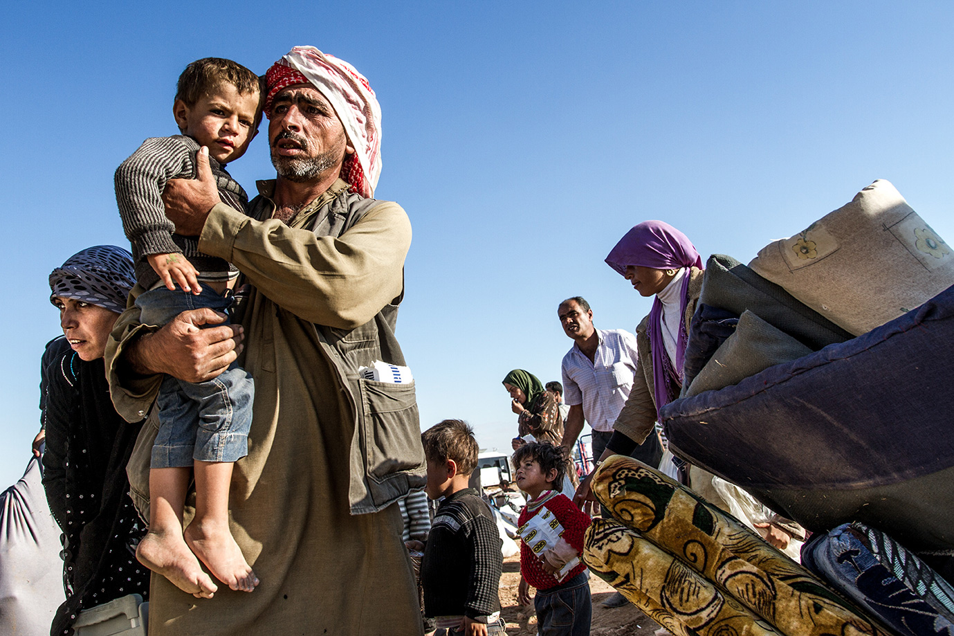 refugees kobane arm child family