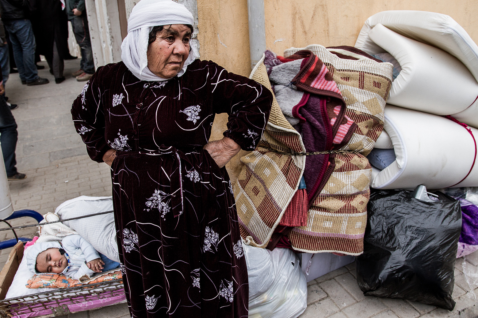 refugee old woman with baby suruc turkey kobane