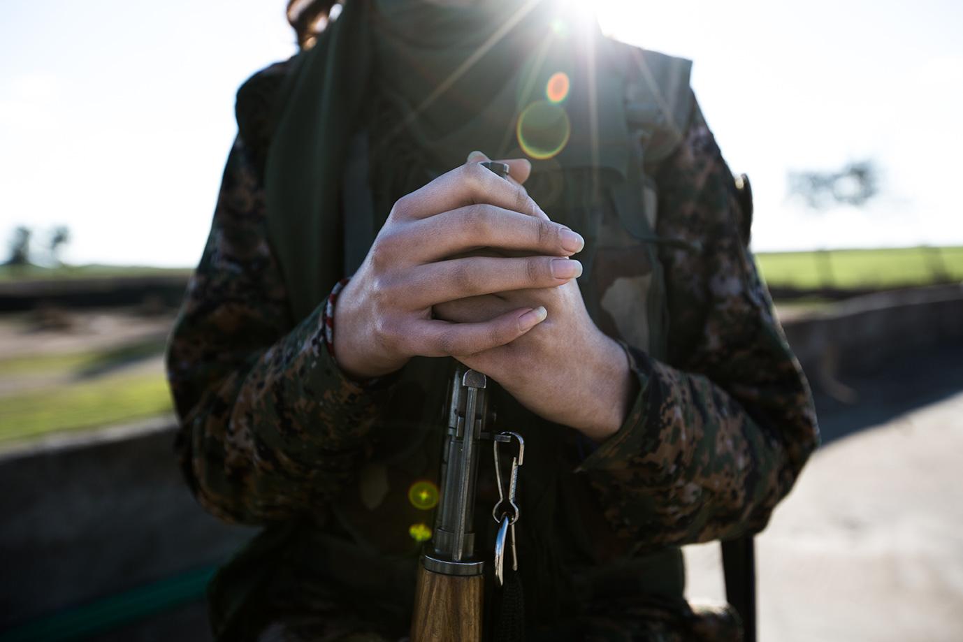christian female fighter hands kalashnikov