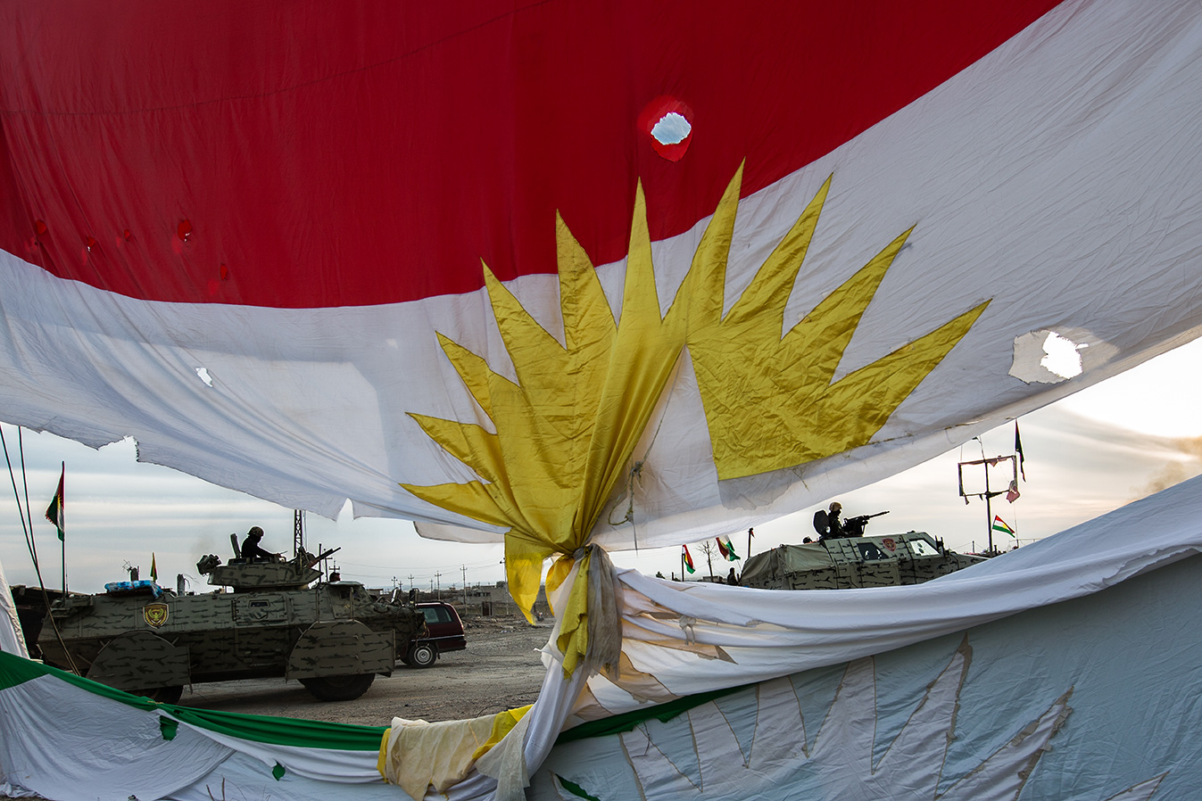 kurdish flag military vehicels background sinjar iraq