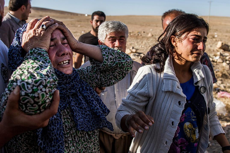 sorrow after lost family member fleeing Syria kobane