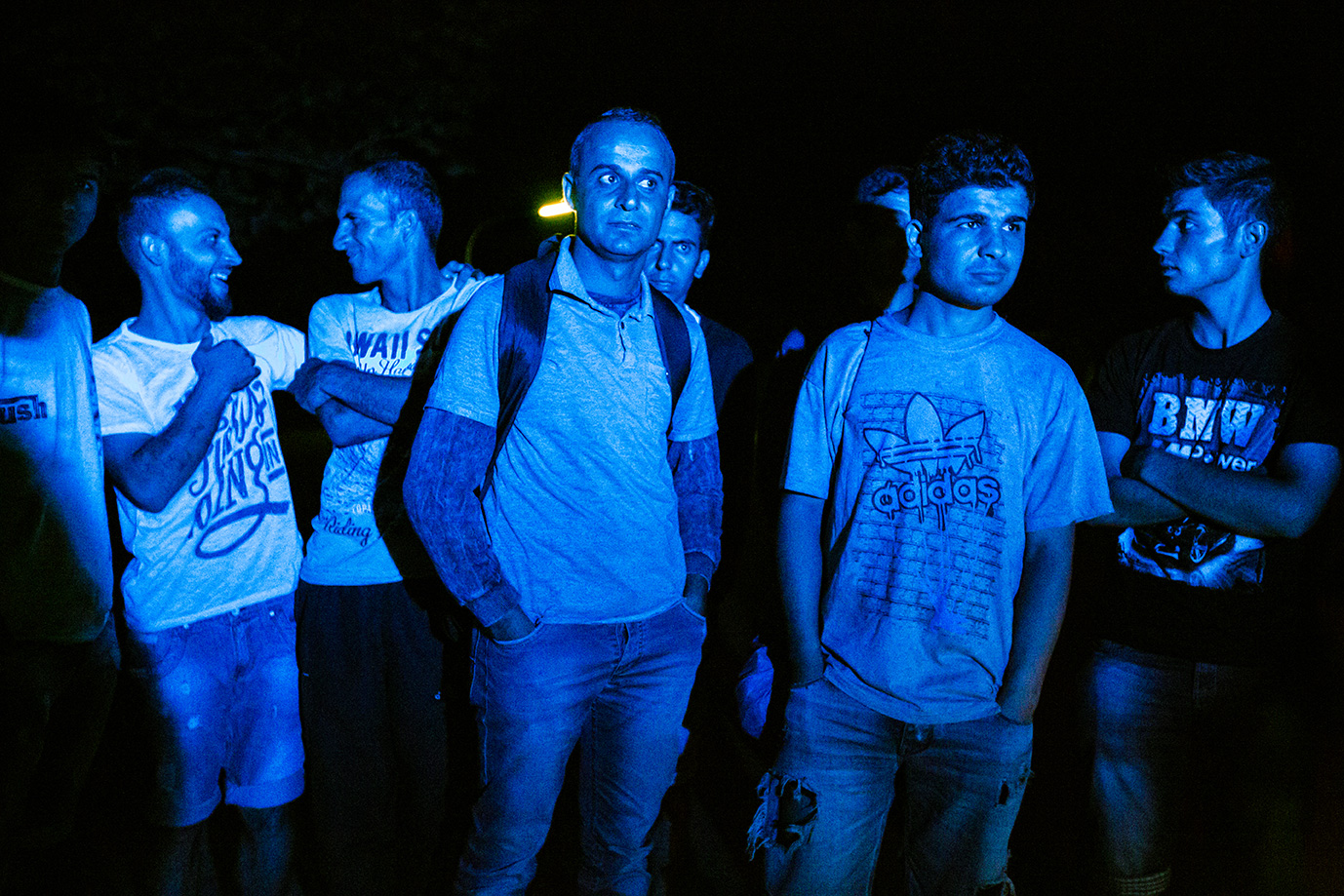 04_Iraqi-christian-refugees-arrive-Germany-blue-police-light