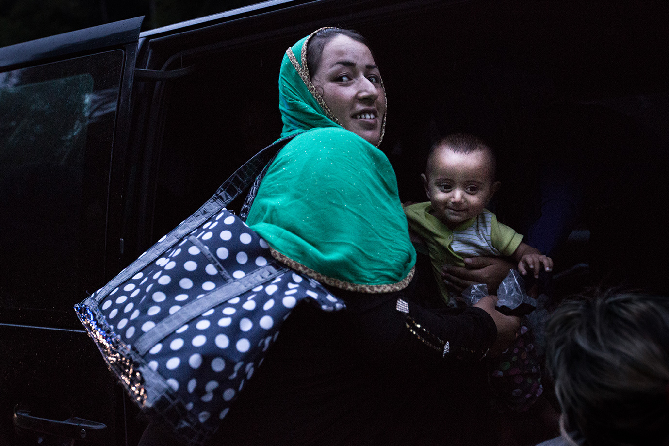 08_mother-baby-get-off-car-human trafficker-arriving-germany