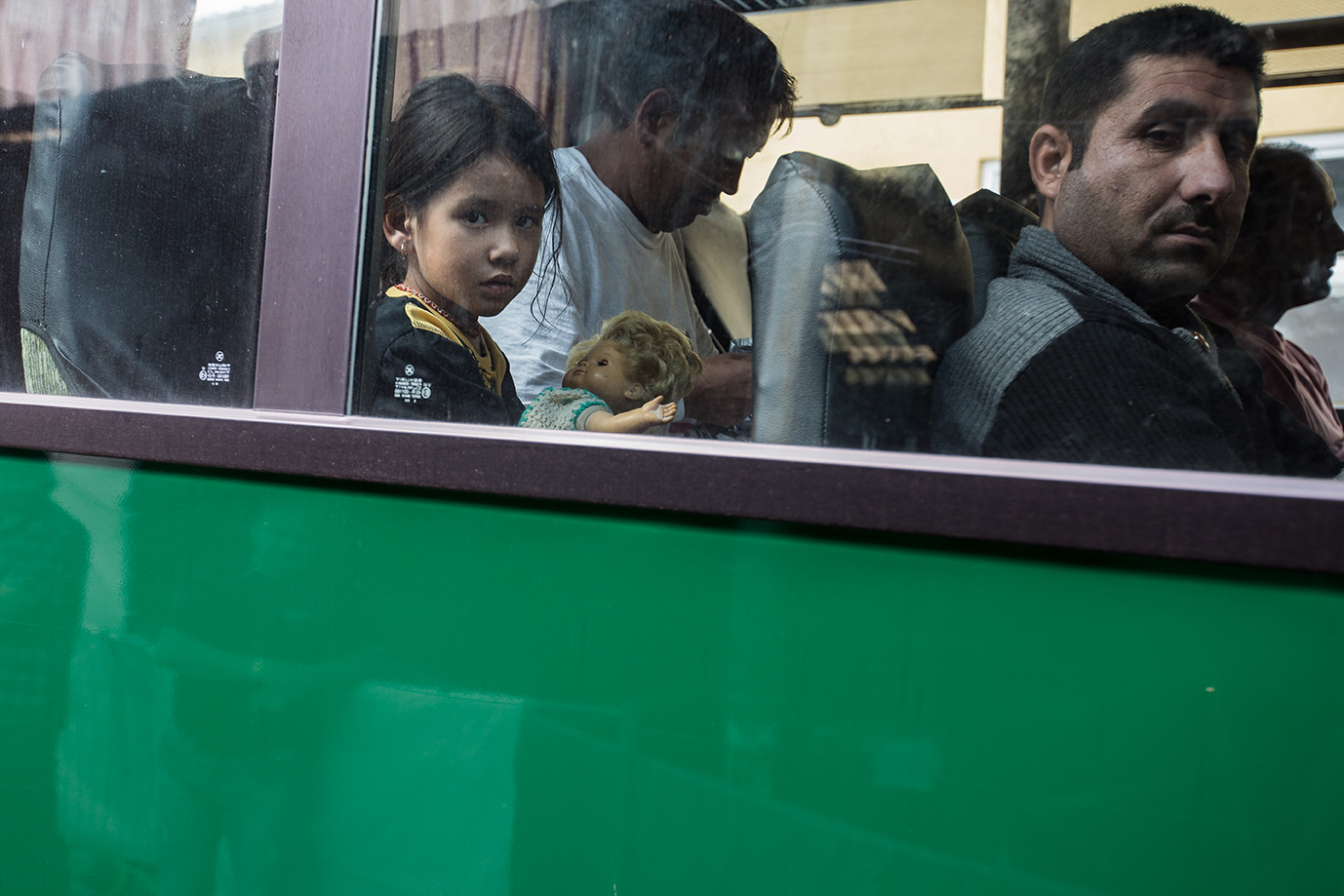 12_young-girl-afghanistan-puppet-police-bus-Germany