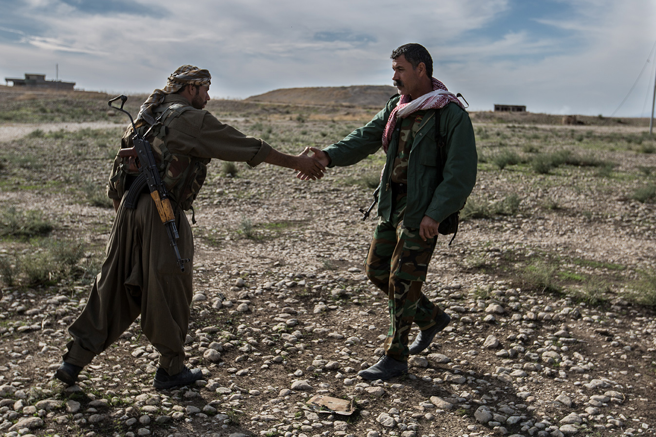 YPG fighter peshmerga fighter handshake liberation sinjar