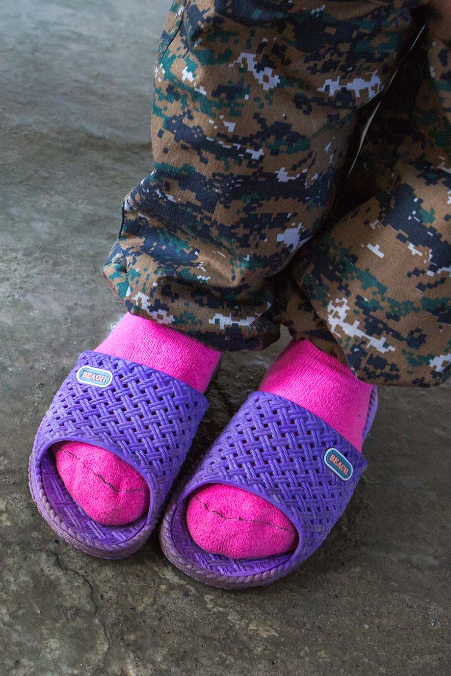 foots female yesidi fighter pink socks camouflage